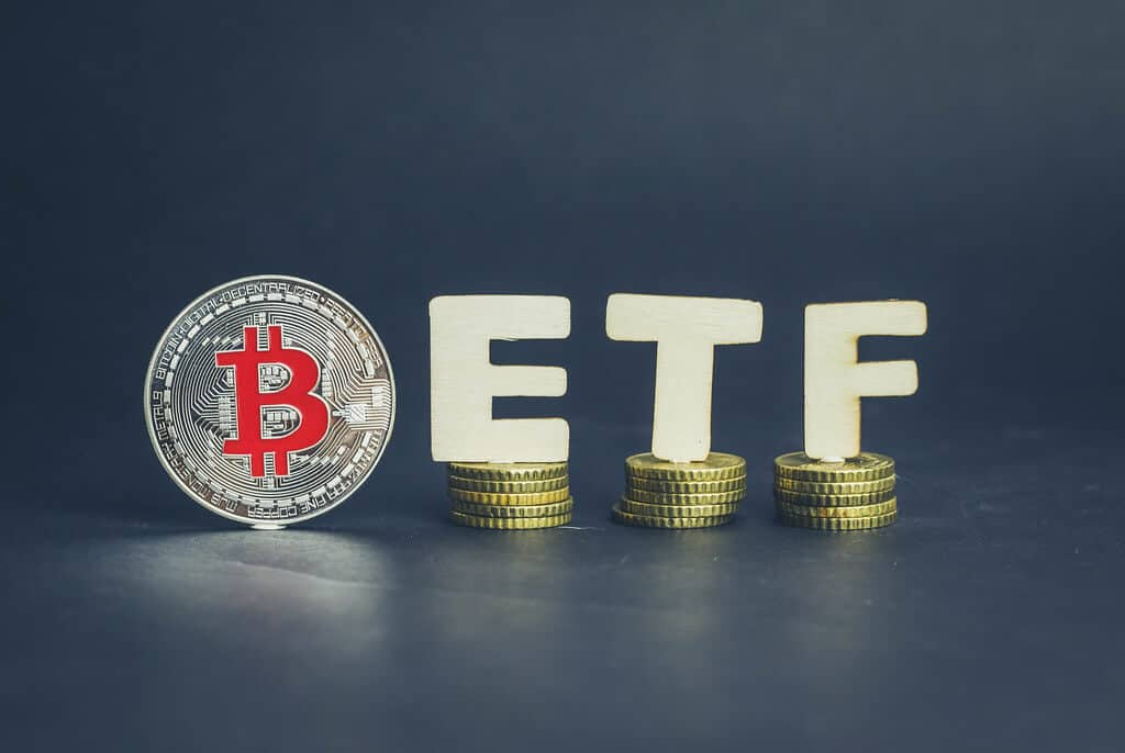 Bitcoin coin with ETF text on coins