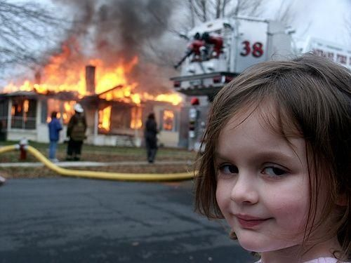Disaster Girl smiling NFT